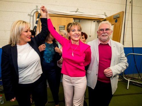 Sinn Fein MLA Martina Anderson (centre), with her husband Paul Kavanagh (right), and Sinn Fein deputy leader Michelle O'Neill (left) (Liam McBurney/PA)