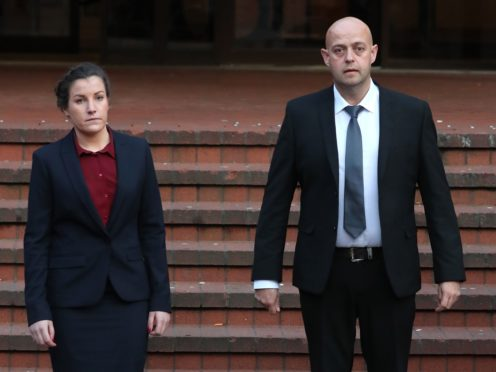 Police constables Benjamin Monk (right), who is accused of the murder of Dalian Atkinson, and Mary Ellen Bettley-Smith (left), who is accused of assaulting him on the same date, leaves Birmingham Crown Court after a review hearing. Mr Atkinson, a former Aston Villa footballer, died after being Tasered near his father's home in Telford in 2016 (PA)