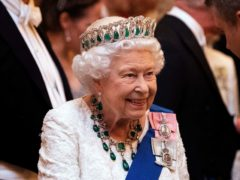 The Queen talks to guests at an evening reception for members of the Diplomatic Corps (Victoria Jones/PA)