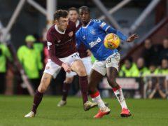 Rangers' Glenn Kamara (right) and Heart of Midlothian's Andy Irvine (Andrew Milligan/PA)