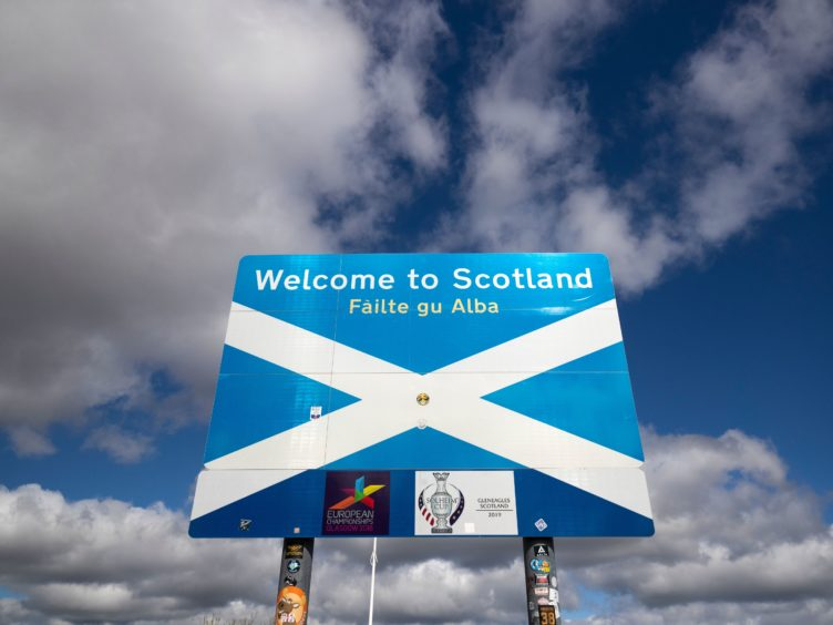 The report examines what lessons Scotland can learn from international examples on immigration (Jane Barlow/PA)