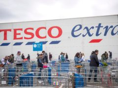 Tesco's profits tumbled by around a fifth over the past year after coronavirus costs of almost £900m offset surging sales (Victoria Jones/PA)