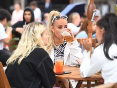 Beer gardens are set to reopen a fortnight earlier in England than in Wales providing a temptation to Welsh people fancying a pint (Victoria Jones/PA)