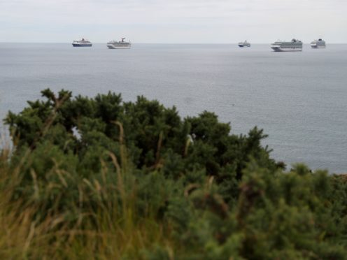 Cruise ships off Portland, Dorset amid a coronavirus-inspired slump in demand (Andrew Matthews/PA)