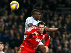 Manchester City's Micah Richards and Liverpool's Jamie Carragher battle for the ball (Dave Thompson/PA)