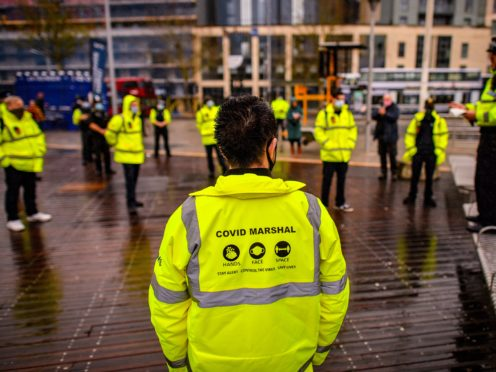 Some councils in England are recruiting Covid marshals for the year ahead (Ben Birchall/PA)