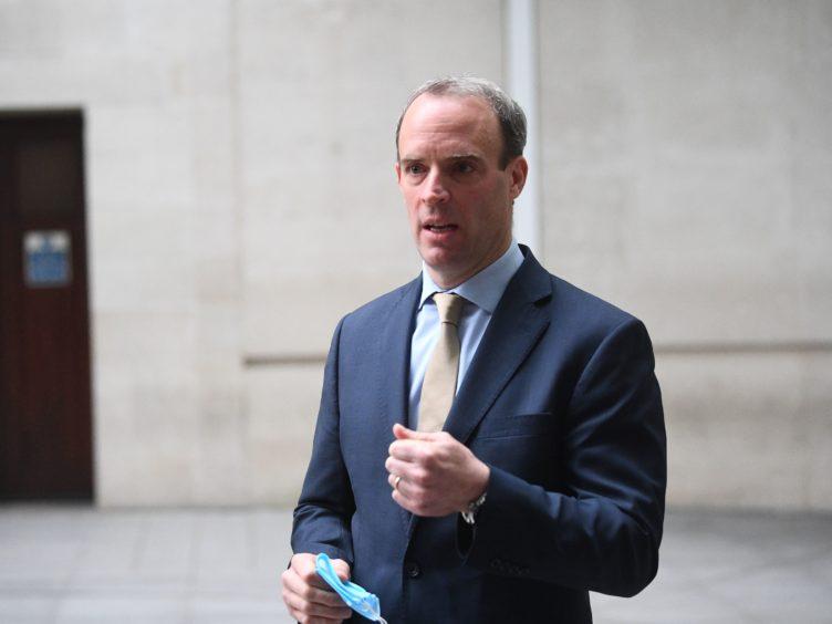 Foreign Secretary Dominic Raab announced the sanctions (Victoria Jones/PA)