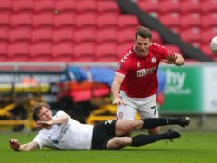 Portsmouth defender Sean Raggett, left, could miss the visit of Burton (David Davies/PA)