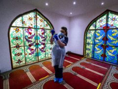 Practice nurse Hannah Currie, 25, prepares a dose of the AstraZeneca vaccine at Bradford Central Mosque, which is doubling as a community Covid-19 vaccination centre (Peter Byrne/PA)