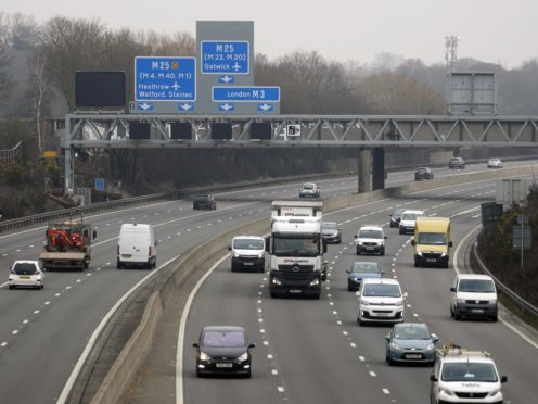The M3 smart motorway near Longcross in Surrey. The motorways have no hard shoulder for emergencies, and use technology to close off lanes. Claire Mercer, the wife of man who died on a smart motorway has paraded his image on giant screen outside a police headquarters as she demanded officers investigate Highways England over his death. Picture date: Tuesday March 2, 2021.