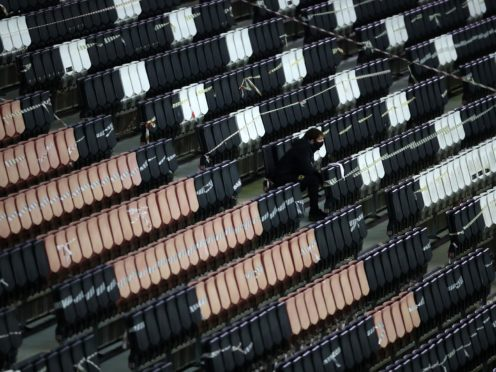 A ball boy watches from the empty stands during MK Dons' Sky Bet League One match against Blackpool (Tim Goode/PA)