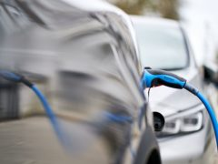 File photo dated 05/03/21 of an electric car charging. The UK is halfway to cutting its greenhouse gas emissions to net zero after a record annual fall in pollution during the pandemic, analysis shows.