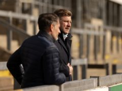 Karl Robinson watched Oxford's match at Crewe in the stand (Steven Paston/PA)
