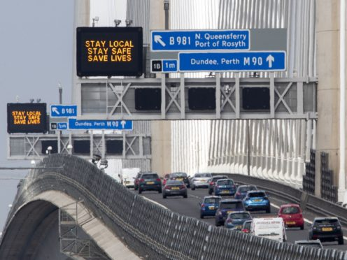 Traffic information signs read 'Stay Local, Stay Safe, Save Lives' above the M90 on the Queensferry Crossing near Edinburgh following the easing of Scotland's lockdown restrictions to allow far greater freedom outdoors (Jane Barlow/PA)