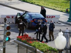 Authorities investigate the scene after a man rammed a car into two officers at the barricade on Capitol Hill in Washington (Alex Brandon/AP)