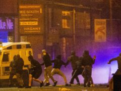 Rioters clash with police in the Sandy Row area of Belfast (Donal Collins/PA)