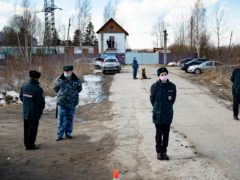 Police officers wearing face masks to protect against coronavirus guard an entrance of the prison colony IK-2, where Alexei Navalny was detained (Pavel Golovkin/AP)