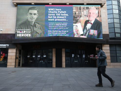 A 100th birthday message for Second World War veteran Charlie Pallett is displayed on a giant advertising screen in London's Leicester Square (Jonathan Brady/PA)