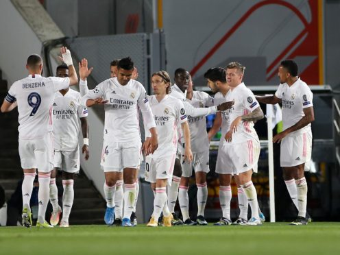 Real Madrid celebrate during their first-leg win over Liverpool (Isabel Infantes/PA)