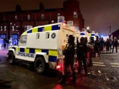 PSNI officers and Land Rovers on the nationalist side of the Springfield Road in Belfast (Liam McBurney/PA)