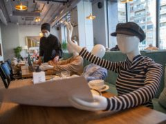Mannequins are positioned at the tables of Bagolina eatery restaurant, as a protest against the latest government Covid-19 lockdown measures in Kosovo capital Pristina (Visar Kryeziu/AP)