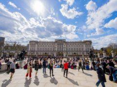 People have gathered outside Buckingham Palace following the death of the Duke of Edinburgh (Ian West/PA)
