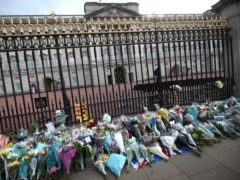 Floral tributes are left outside Buckingham Palace (Yui Mok/PA)