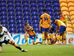 Mansfield celebrate Tyrese Sinclair's late equaliser against Newport (Zac Goodwin/PA)
