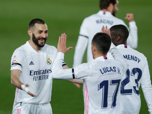 Karim Benzema, left, celebrates his goal with his Real Madrid team-mates (Manu Fernandez/AP)