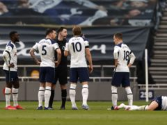 Son Heung-min, right, fell to the ground holding his face as Manchester United thought they had opened the scoring (Adrian Dennis/PA)