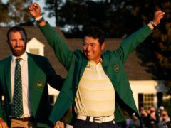 Hideki Matsuyama, right, receives the green jacket from 2020 winner Dustin Johnson (David J. Phillip/AP)