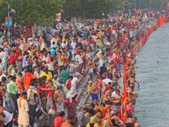 Devotees take holy dips in the River Ganges during Shahi snan or a royal bath at Kumbh Mela in Haridwar in the Indian state of Uttarakhand (Karma Sonam/AP)