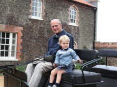 Duke of Edinburgh with Prince George in Norfolk in 2015 (Duchess of Cambridge/PA)