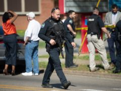 A pupil who opened fire on officers responding to a report of a possible gunman at a Tennessee high school has been fatally shot by police (Saul Young/The News Sentinel/AP)