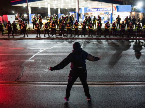 A demonstrator heckles authorities during a protest against the police shooting of Daunte Wright (John Minchillo/AP)