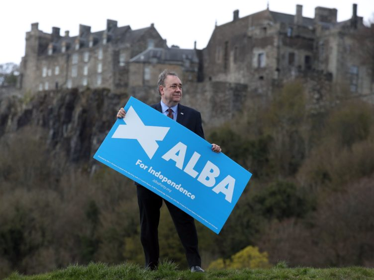 Alex Salmond said the SNP and the Greens would 'kick the independence timetable down the road' (Andrew Milligan/PA)
