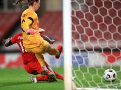 Nichelle Prince, left, pounces on a mistake from Karen Bardsley to score the second goal (Mike Egerton/PA)