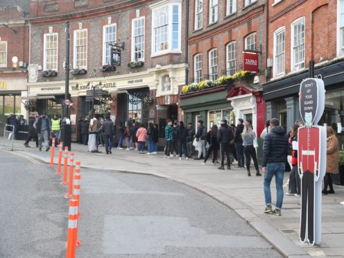 People queue outside the Wetherspoon's King and Castle pub in Windsor, following the further easing of lockdown restrictions in England (Steve Parsons/PA)