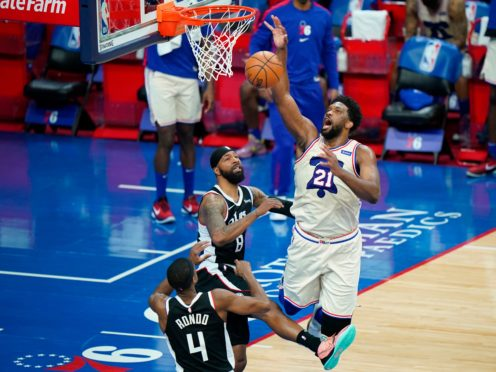 Joel Embiid, right, poured in 36 points and had 14 rebounds (Matt Slocum/AP)
