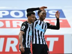 Joe Willock (right) celebrates scoring the winner (Stu Forster/PA)