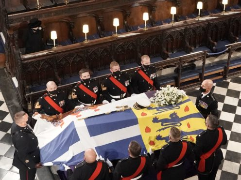 The Queen watches as the coffin of the Duke of Edinburgh is placed in St George's Chapel (Jonathan Brady/PA)