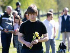 People observe a minute's silence on the Long Walk outside Windsor Castle (Andrew Matthews/PA)