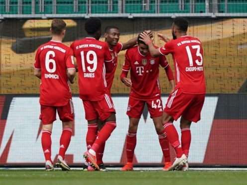 Jamal Musiala, second right, became the youngest player to reach six Bundesliga goals in Bayern Munich's win at Wolfsburg (Michael Sohn/AP)