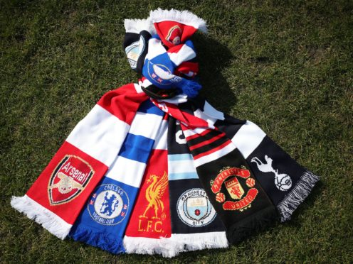 A selection of scarves pictured at Hackney Marshes, London, of the English soccer Premier League teams (left-right) Arsenal, Chelsea, Liverpool, Manchester City, Manchester United and Tottenham Hotspur, who announced in a joint statement they are to join a new European Super League (Yui Mok/PA)
