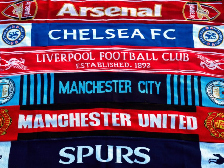 Football scarves (John Walton/PA)