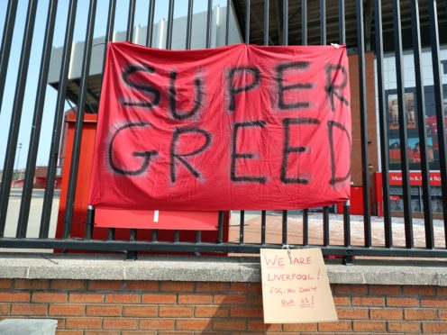A banner outside Anfield in Liverpool protesting about the club's decision to join the European Super League (Peter Byrne/PA)