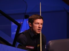 Jack Lisowski fought back to secure his place in the second round at the Crucible (George Wood/PA)