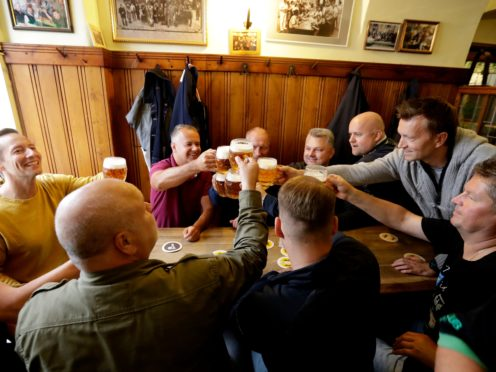 Customers cheer with beer at a pub in Prague, Czech Republic (Petr David Josek/AP)