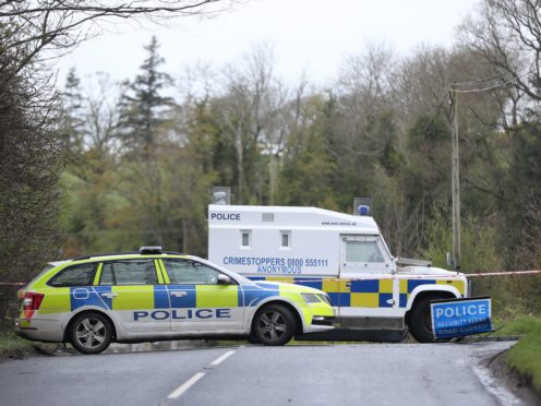PSNI vehicles blocking a road during the security operation (Niall Carson/PA)