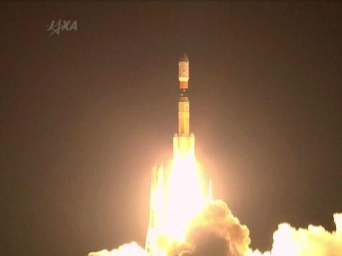 A rocket lifts off from a launch pad at the Tanegashima Space Centre in Tanegashima, southern Japan (JAXA via AP video)